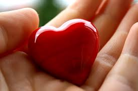this is my favourite picture for the blog Caron Cares. It shows a glass heart in a hand.