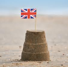 this picture shows a sandcastle with a union Jack in