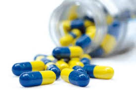 this image shows a bottle of yellow and blue tablets