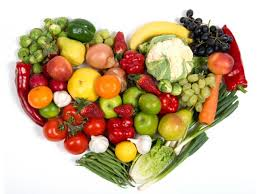 this image shows a heart made from fruit and veg
