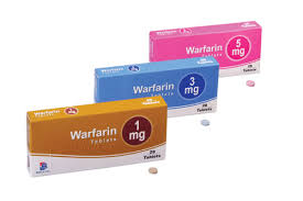 this image shows three boxes of warfarin. Brown 1mg, Blue 3 mg and Pink 5mg