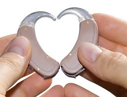 this image shows two hearing aids making a heart shape.