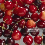 this image shows a selection of red cherries
