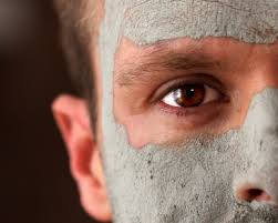 this image shows a man with a face pack on