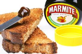 this image shows a picture of a jar of marmite and some toast