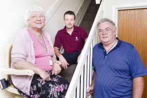 an elderly woman and her son and a stairlift