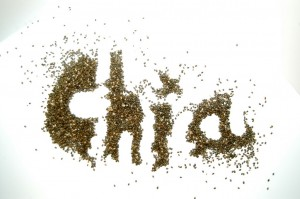 the word chia spelt in chia seeds on a white background