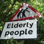 triangle road sign of two elderly people walking