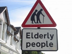 elderly road sign red triangle with an elderly man and woman inside