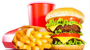 this image shows fries, a burger and a drinks cup