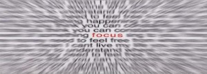 a very blurred piece of text with the only word in focus being focus in red