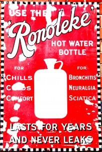 red advertisement with white writing advertising the medicinal benefits of a hot water bottle
