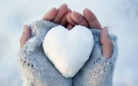 this image shows a pair of hands with grey fingerless gloves holding and ice heart