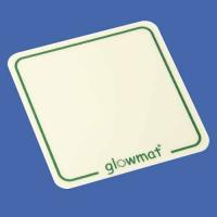 blue background and a white coaster with a green border and the wording glowmat