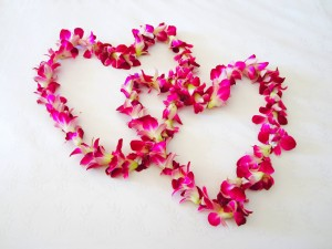two hearts on a white background. The hearts are made from flowers