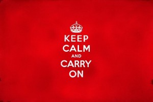 a red square with the words Keep calm and carry on in white writing