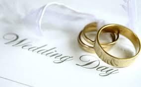 this image shows two wedding rings and the words wedding day