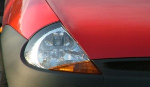 the light and bumper of a red ford ka