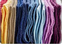 this image shows lots of lovely coloured socks from cosey feet.