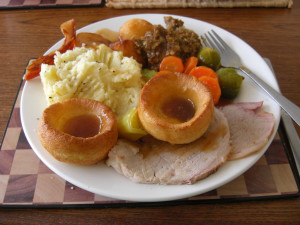 a plate of roast pork and all the trimmings