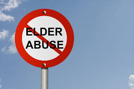 this image shows a street sigh with the words elder abuse on it and a red line through it