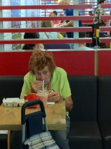an elderly woman eating alone in McDonalds