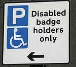 A sign showing disabled badge holders and a Parking P