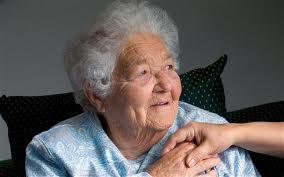 an elderly having her hand held