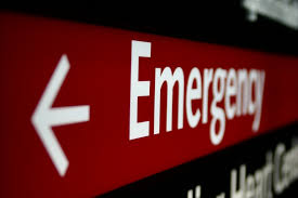 a red sign with the word emergency on
