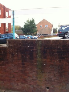 this picture shows a steep car park and cars parked in it