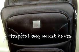 this image shows a black bag and the words hopital bag must haves