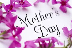 """this image shows some flowers surrounding the words """"Mothers Day"""""""
