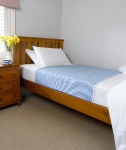 this picture shows a blue draw sheet for a single bed.