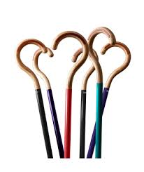 this image shows 6 different coloured walking sticks with lovely wooden curved handles