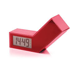 this image shows a lexon alarm clock in red.