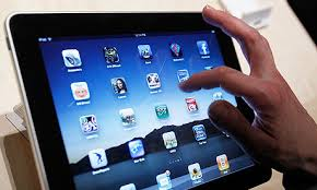 this image shows and ipad and someones hand