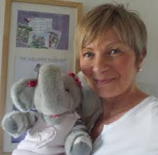 this image shows Irene Mackay and her elephant ellie who she uses to educate children about dementia.