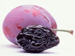 this image shows a plum and a prune