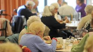 this image shows some elderly people at a day centre