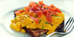 this image shows scrambled egg and smoked salmon.
