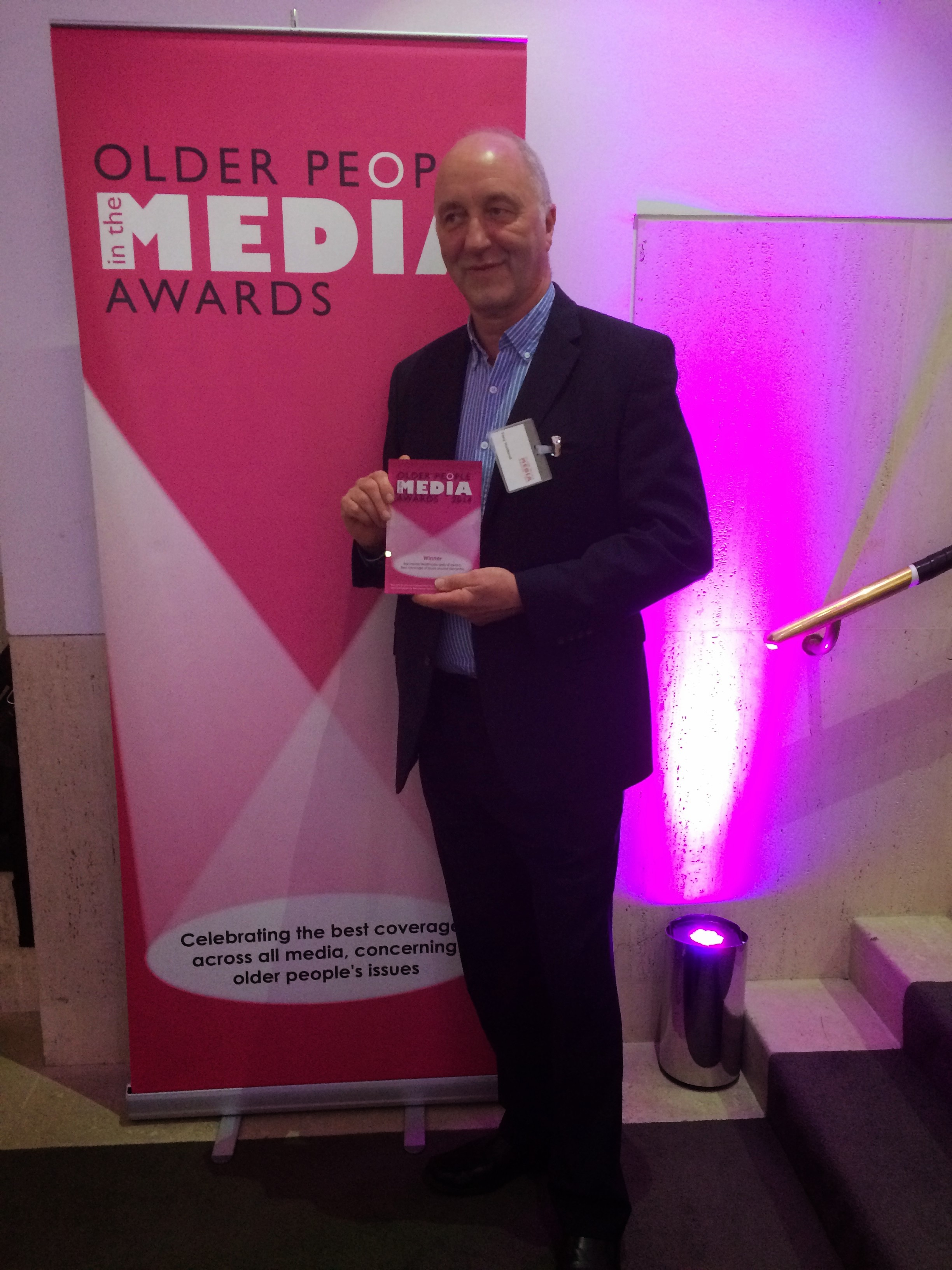 this photo shows Tony Husband with his award
