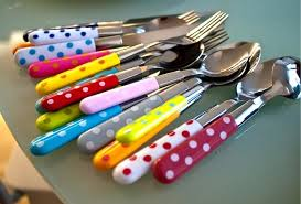 this image shows a collection of funky brightly coloured cutlery.