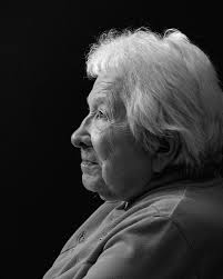 this is a black and white photo of an elderly lady