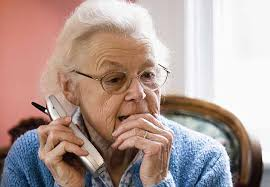 this image shows an elderly person on the phone