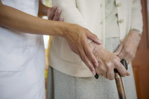 this image shows and elderly person and her carers hand