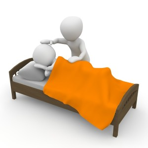 Cute image of two figures, one in bed and one stood beside