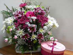 this image shows flowers and chocolates.