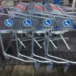 this image shows a row of Tesco trolley for use with a wheelchair