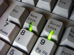 this image shows a few keys on a raised computer keyboard