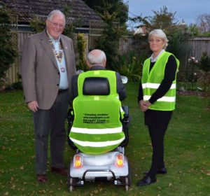 this is a photo of me sporting a high vis vest as part of my bid to keep mobility scooter users safe.